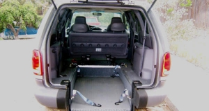 Older models of 2000 Dodge Caravan wheelchair van with rear entry